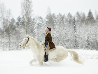 White horse and riding woman