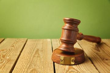 Judge gavel on wooden vintage background