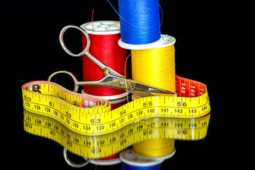 Measuring tape and scissors with thread