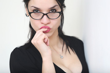 Portrait of beautiful young woman in glasses