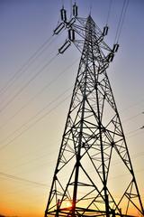 a pillar of high voltage in dim light of dawn