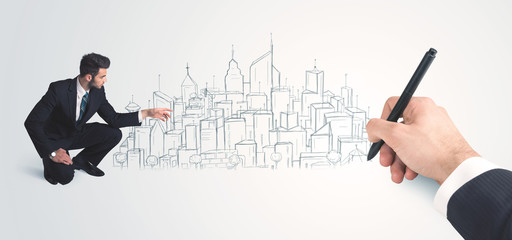 Businessman looking at hand drawn city on wall