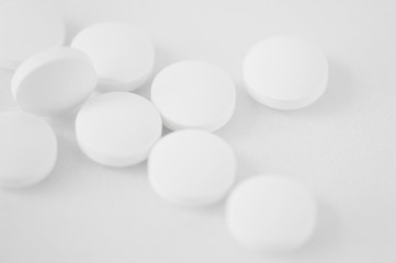 abstract background - a scattering of white tablets