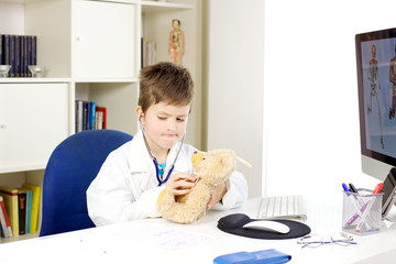 Serious very young doctor working in office