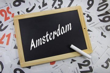 Amsterdam auf eine Tafel geschrieben
