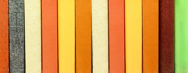 Close-up of title-less books in bookshelf
