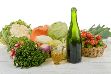 Glass and bottle of cider with vegetables
