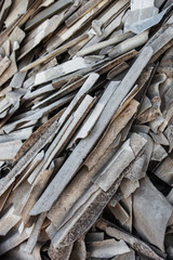 Pile of the old and damaged wavy roofing slates