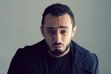 Man with sad expression..