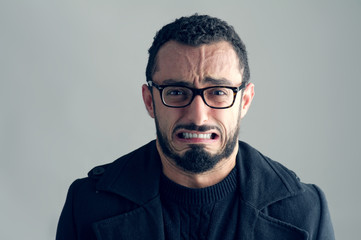 Man with Frustrated Expression isolated on grey