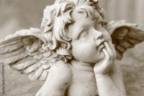 Papiers peints Statue image of cherub figurine in sepia