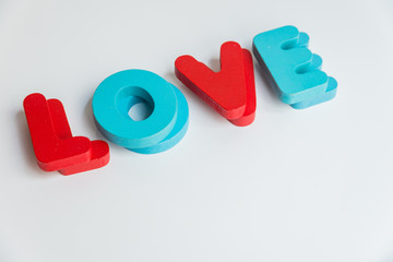 Double Wooden word LOVE on White background