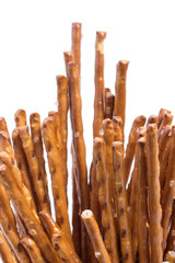 Closeup of many salt sticks, isolated on white background