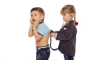 little girl listening stethoscope boy