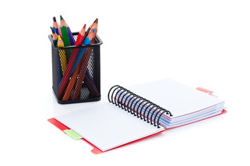 Colorful pencils and office notepad