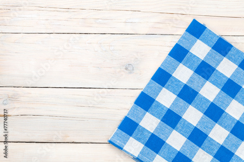 Blue towel over wooden kitchen table - 77740737