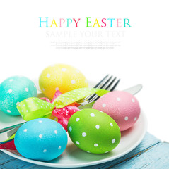 colorful easter eggs and cutlery isolated