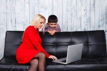 Mother And  Son Using Laptop At Home