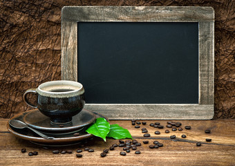 coffee, antique blackboard, coffee leaves and beans. retro style
