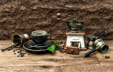 Nostalgic still life with cup of coffee and antique accessories