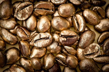 golden coffee beans. background. texture