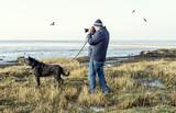 Fotograf an der Küste