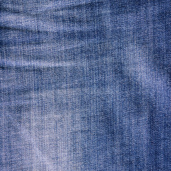 Crumpled vintage jeans texture.