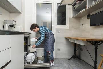Child emptying the dishwasher