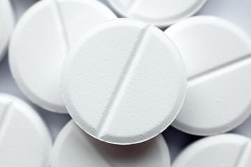 Heap of white round pills, close-up