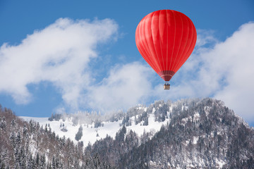 Balloon over winter landscape
