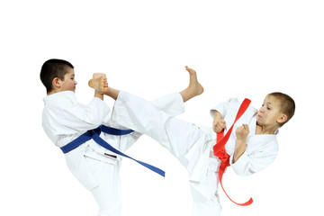 Kick and hand block dressed in white on a white background