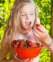 Child with strawberry