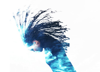 Double exposure of girl throwing braids and cloudscape
