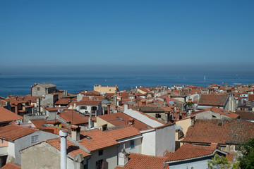 View to red roofs and Piran Gulf in Adriatin Sea