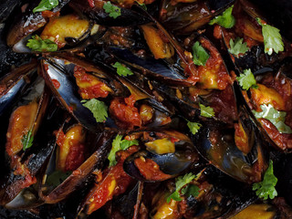 black mussel in tomato sauce food background
