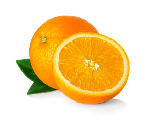 Ripe orange fruit with leaves and slices isolated on white