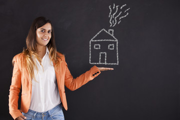 Woman showing a house drawing