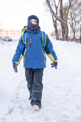 Child Boy on His Way to School During Winter