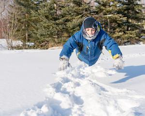 Child Boy Having Fun in the Snow