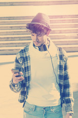 guy watching smart phone in the street  instagram effect