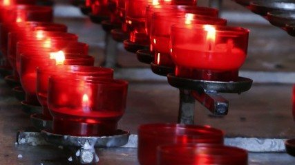 Wish Praying Red Candles in Church