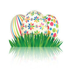 Easter eggs with colorful patterns and green spring grass