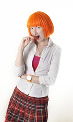 girl with red hair dressed as schoolgirl sucks a lollipop