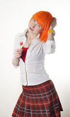 girl with red hair dressed as schoolgirl and lollipop