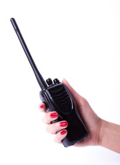 Female hand holding portable radio transmitter