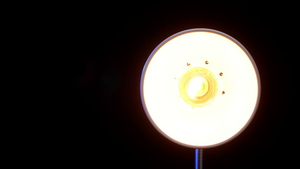 Real floor lamp turning on, flickering and turning off