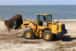 Tractor cleans the beach