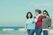 Three best friends walking at seaside