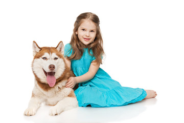 Girl with a husky, isolated on white