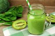 Healthy green smoothie with spinach and kiwi in a jar mug - 77758578